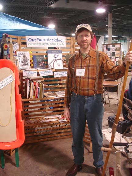Me at my booth. Maybe it needs a braided oval rug and rocking chair and end table.